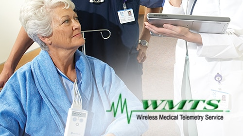 A senior female patient is communicating with caregivers.