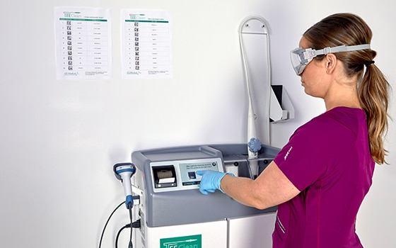 Medical professional using the TEEClean quick 2-minuet clean cycle combined with a 5-minuet high-level disinfection cycle