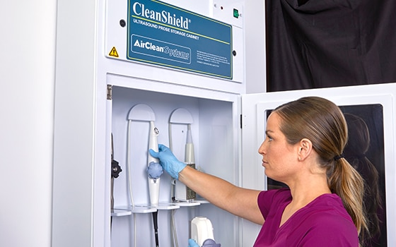 Medical Professional storing disinfected transducers in CleanShield Storage Cabinets.