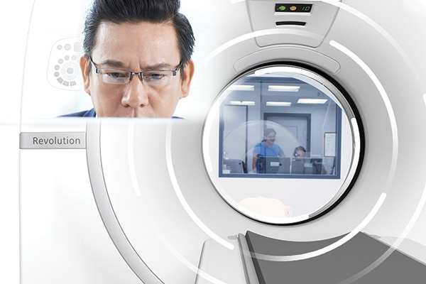 A radiologist uses GE Healthcare's OnWatch preventive maintenance solution to detect abnormalities in the machine.