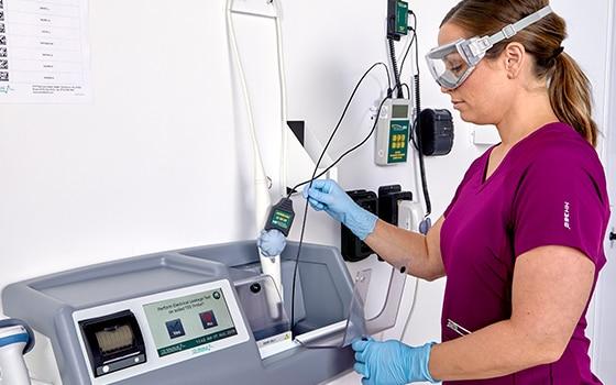 Medical professional using TEEZyme Enzymatic Sponge