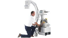 technician with surgery oec machine.